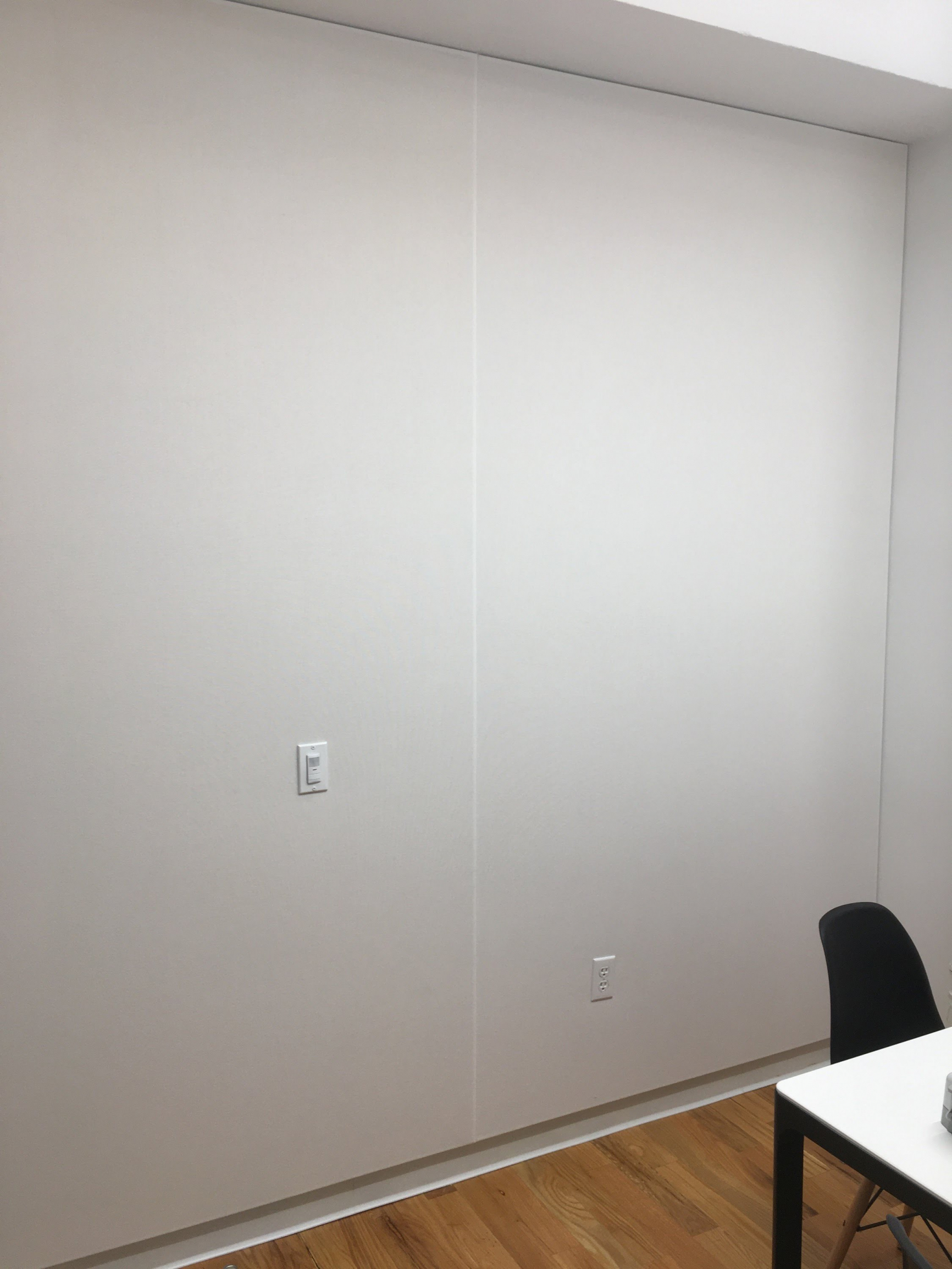White Acoustic Fabric Wall in Conference Room